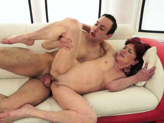 Redhead granny spoon fucked by younger guy