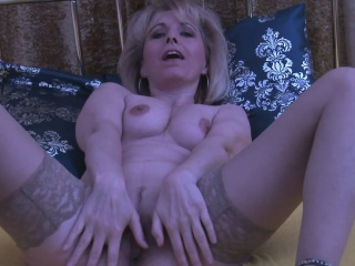 Mature blonde displays her wet love tunnel