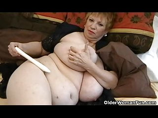 Fat granny with massive mammaries plays with vibrator