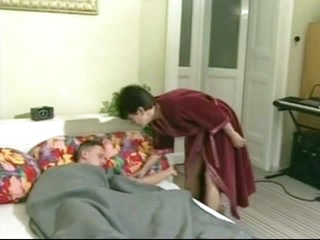 Aged granny landlady wakes her youthful lodger with a fuck
