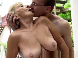 Busty granny doggystyled by young cock