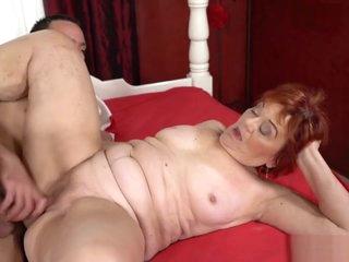Fat redhead grandma Marsha with young man 1.
