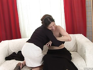 Brunette granny plays naughty with a horny lesbian