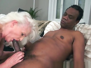 Alluring Granny Sucking On A Huge Black Dick