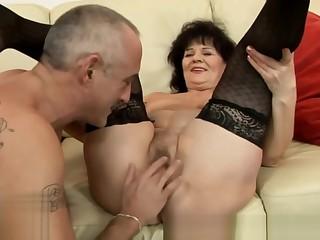 Mature hairy granny in lingerie gets dildo