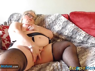 EUROPEMATURE - Lexie starts playing with the piercings of her pussy