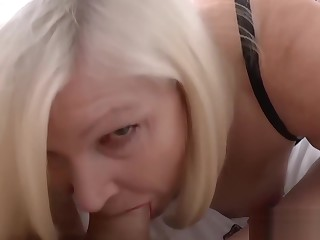 Big titty GILF takes hard cock deep down her lush mouth