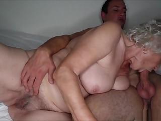 Granny with large boobs enjoying hardcore sex