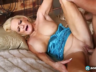 Mature blonde slut, Layla Rose is getting fucked hard in the cottage, while playing with her boobs