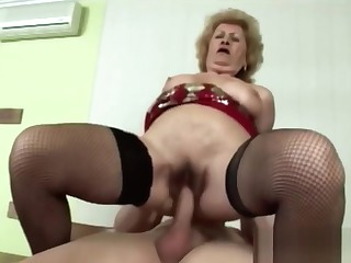 Busty Granny Gets Down And Dirty