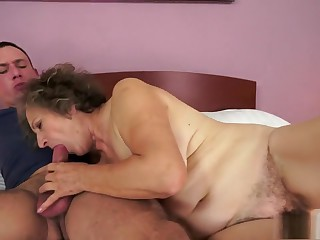 Wild granny gives a nice blowjob and gets banged deep by a young stud
