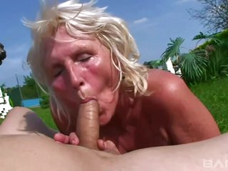 Busty granny is sucking dick and getting fucked in a public place and enjoying it a lot