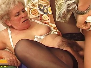 Hairy Hungarian granny is sucking a much younger guys dick and getting fucked hard, in return