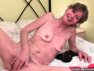 Hairy granny Vikki gets her furry hole fingered